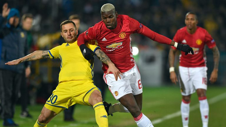 Manchester United midfielder Paul Pogba (right) battles for possession with Rostov'defender Fedor Kudryashov