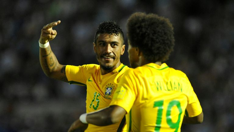 Paulinho (left) celebrates with Willian after netting his second of three goals against Uruguay