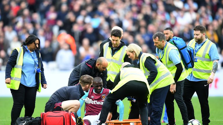 Pedro Obiang receives treatment after injuring his ankle against Leicester