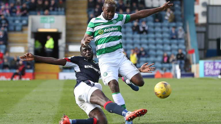 Dundee defender Kevin Gomis tackles Celtic striker Moussa Dembele