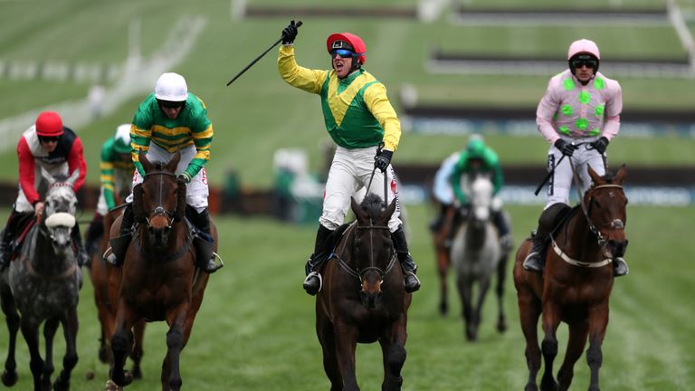 Jockey Robbie Power (centre) celebrates after his winning ride on Sizing John in the Timico Cheltenham Gold Cup