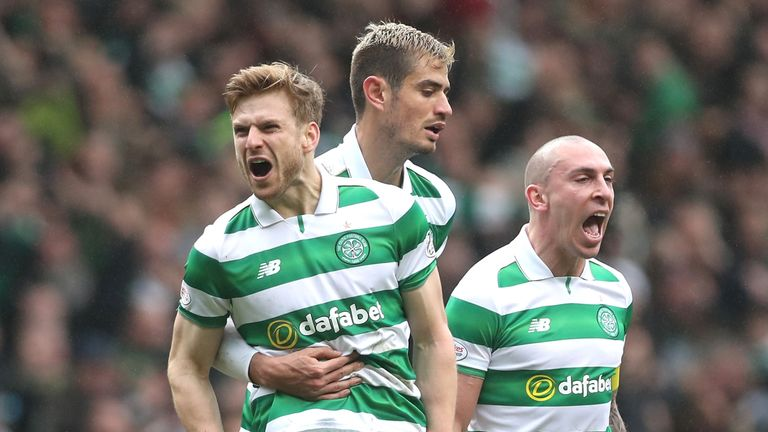 Stuart Armstrong celebrates his first-half strike at Celtic Park