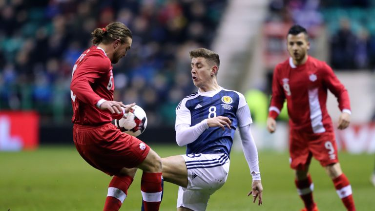 Tom Cairney (right) was handed his debut for Scotland on Wednesday