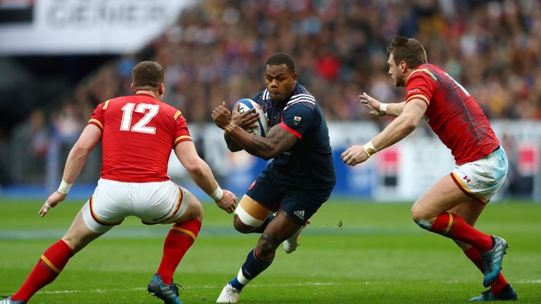 Virimi Vakatawa of France is tackled by Scott Williams and Dan Biggar