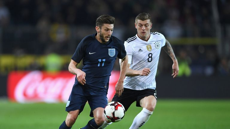 DORTMUND, GERMANY - MARCH 22: Adam Lallana of England (L) is put under pressure from Toni Kroos of Germany (R) during the international friendly match betw