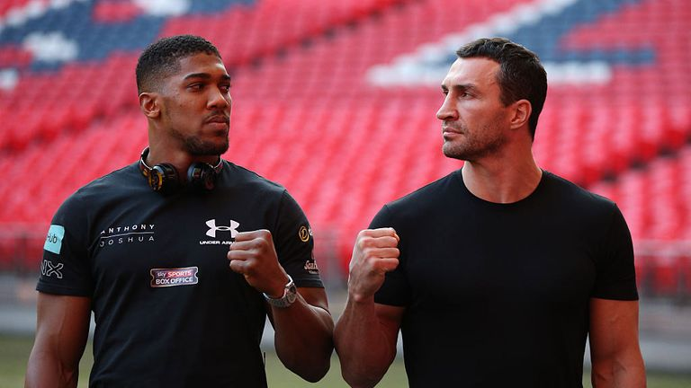 Britain's Anthony Joshua (L) poses with Ukraine's Wladimir Klitschko