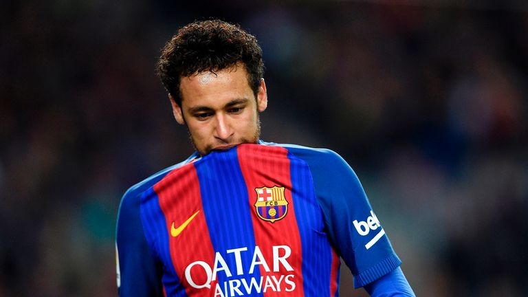 Neymar bites on his jersey during the La Liga match against Valencia at the Camp Nou