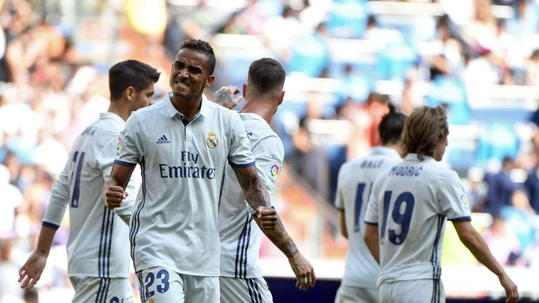 Real Madrid's Brazilian defender Danilo (L) celebrates after scoring during the Spanish league football match Real Madrid CF vs CA Osasuna at the Santiago