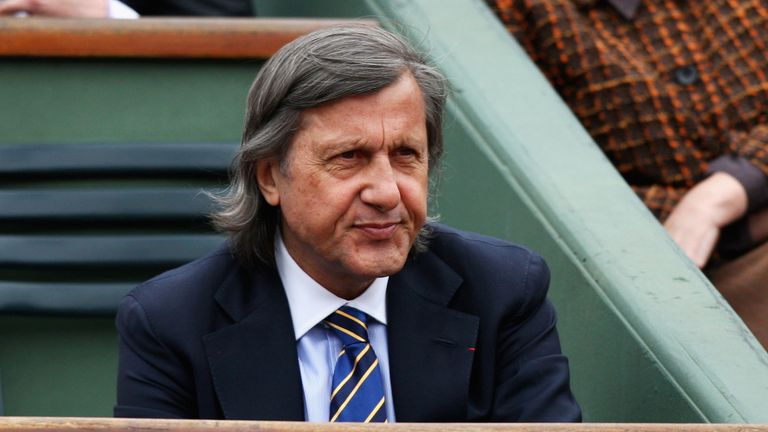 Former tennis player Ilie Nastase watches the action during Women's Singles match at the French Open