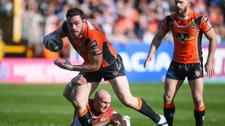 Castleford's Grant Millington is tackled by Catalans' Luke Walsh.