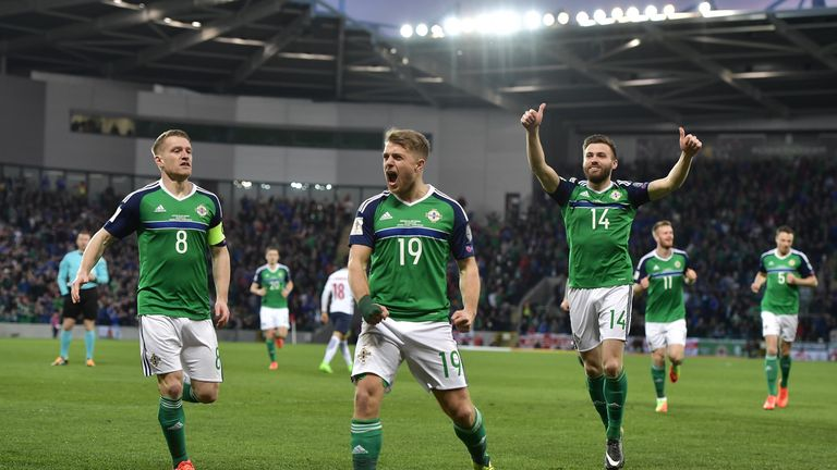 BELFAST, NORTHERN IRELAND - MARCH 26: Jamie Ward (C) of Northern Ireland celebrates scoring with team mates during the FIFA 2018 World Cup Qualifier betwee