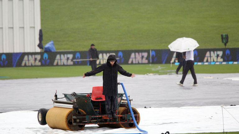 Rain delays the start of play during day five of the third Test cricket match between New Zealand and South Africa at Seddon Park in Hamilton on March 29,