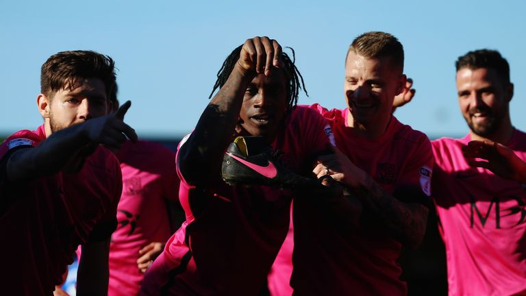 Nile Ranger (2nd L) of Southend United celebrates with team-mates