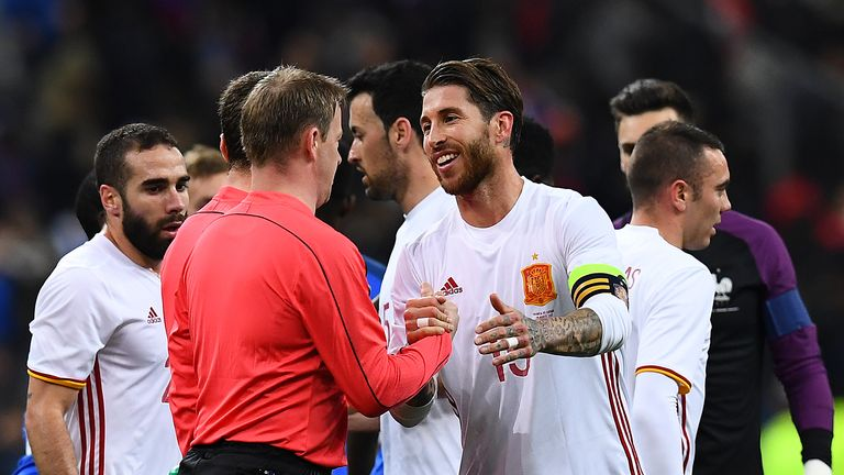Spain's defender Sergio Ramos (R) skahes hands with a referee at the end of the friendly football match France vs Spain on March 28, 2017 at the Stade de F