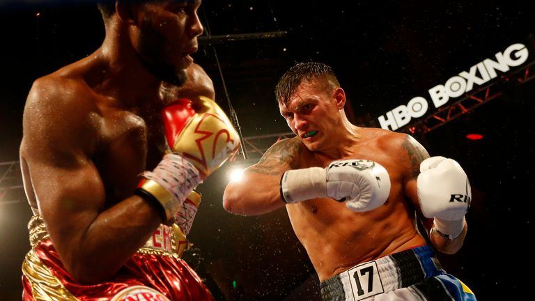Aleksandr Usyk (right) takes on Marco Huck in the Super Series opener