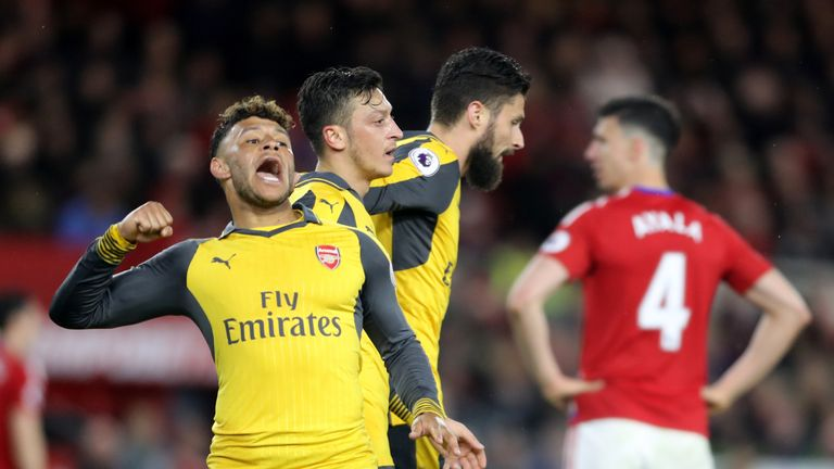 Oxlade-Chamberlain celebrates after Mesut Ozil's goal, which turned out to be the match-winner