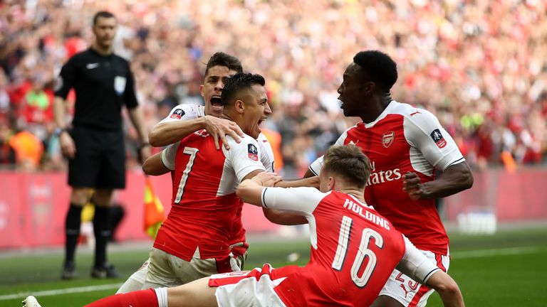 Alexis Sanchez celebrates scoring Arsenal's second of the game in extra-time