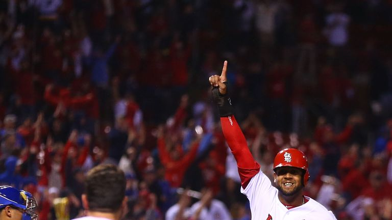 Jose Martinez celebrates scoring the winning run for the Cardinals in the ninth