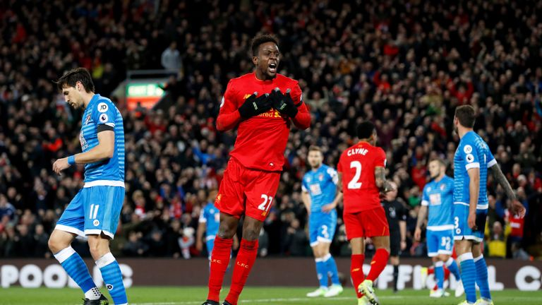 Divock Origi celebrates after his goal gives Liverpool a 2-1 lead