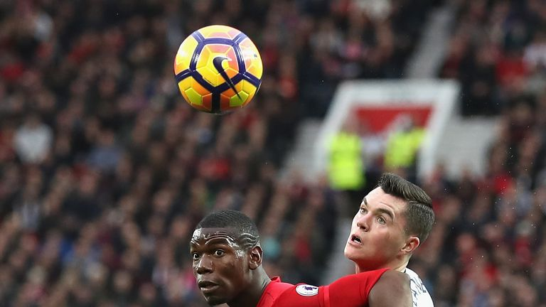 Michael Keane battles for possession with Manchester United's Paul Pogba
