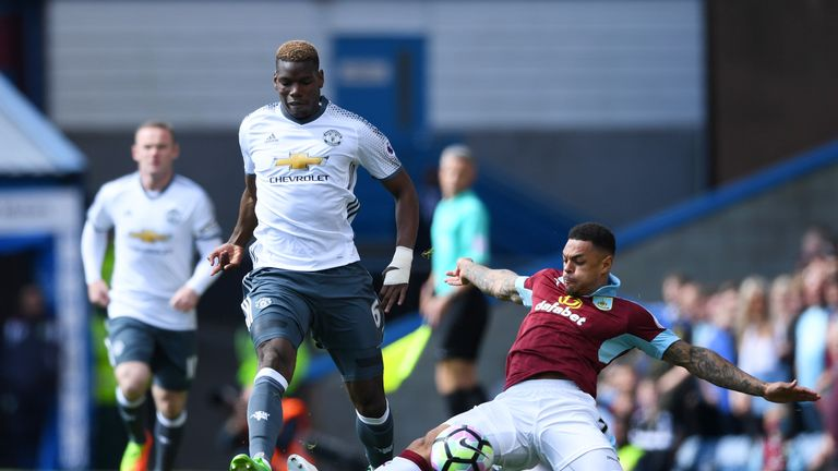Paul Pogba (left) takes on Andre Gray in the early stages at Turf Moor