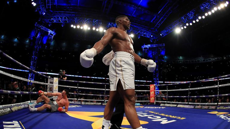 LONDON, ENGLAND - APRIL 29:  Anthony Joshua (White Shorts) puts Wladimir Klitschko (Gray Shorts) down in the 11th round during the IBF, WBA and IBO Heavywe
