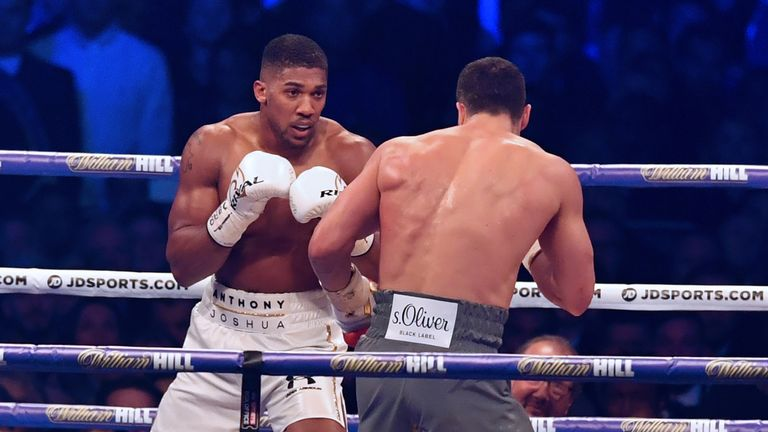 Britain's Anthony Joshua (L) looks for an opening against Ukraine's Wladimir Klitschko during the third round of their IBF, IBO and WBA, world Heavyweight