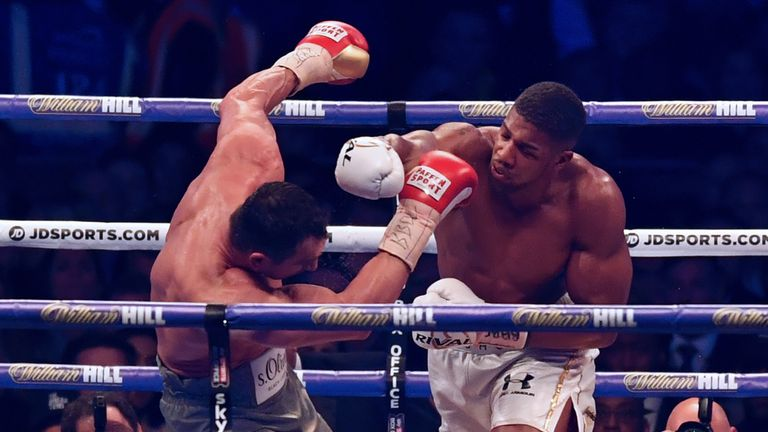 Britain's Anthony Joshua (R) throws a punch at Ukraine's Wladimir Klitschko during the ninth round of their IBF, IBO and WBA, world Heavyweight title fight