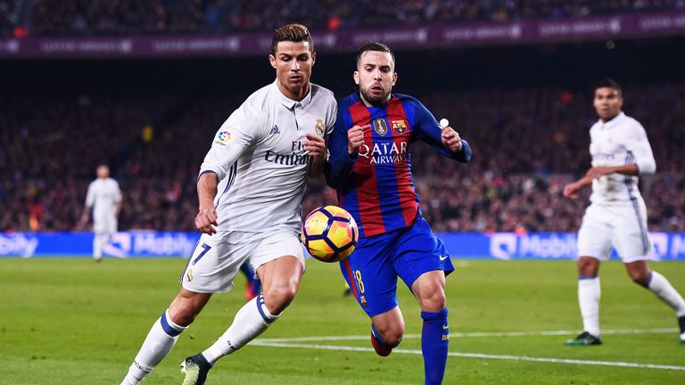 Cristiano Ronaldo and Jordi Alba battle for possession at the Camp Nou