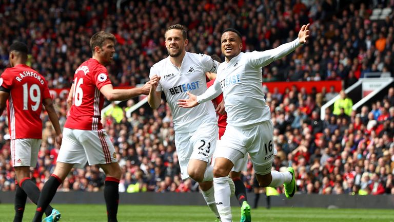 MANCHESTER, ENGLAND - APRIL 30:  Gylfi Sigurdsson of Swansea City celebrates scoring his sides first goal with Martin Olsson of Swansea City during the Pre