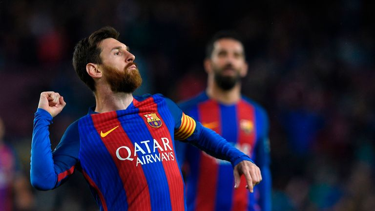 Barcelona's Argentinian forward Lionel Messi celebrates after scoring a goal during the Spanish league football match FC Barcelona vs CA Osasuna at the Cam