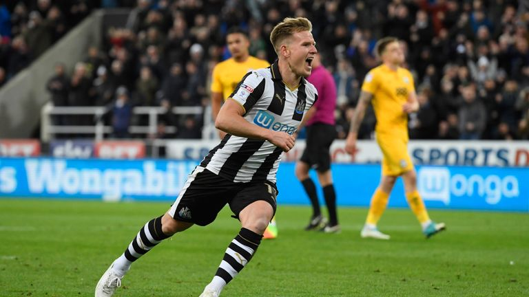 Matt Ritchie of Newcastle United celebrates as he scores their third goal from a penalty against Preston