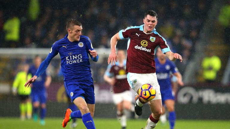 Michael Keane is pressured by Jamie Vardy during the Premier League match between Burnley and Leicester