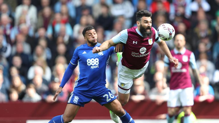 Aston Villa's Mile Jedinak (right) is challenged by Birmingham City's David Davis