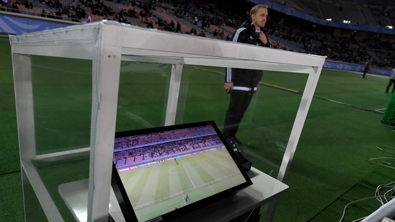 The video assistant referee system is placed beside the pitch prior to the Club World Cup semi-final