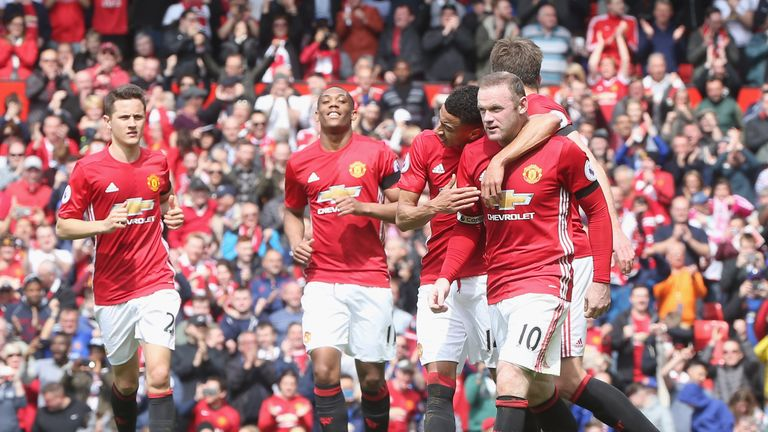 Wayne Rooney is congratulated by his Manchester United team-mates after scoring a penalty against Swansea