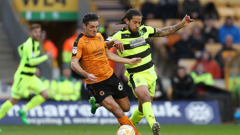 Wolverhampton Wanderers Andi Weimann is challenged by Huddersfield Town's Sean Scannell during the Sky Bet Championship match at Molineux Stadium, Wolverha