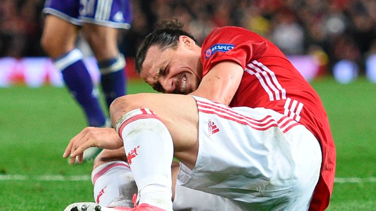 Manchester United's Swedish striker Zlatan Ibrahimovic reacts after falling awkwardly during the UEFA Europa League quarter-final second leg football match