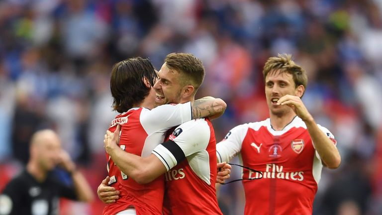 Aaron Ramsey hugs Hector Bellerin after his goal proved to be the winner
