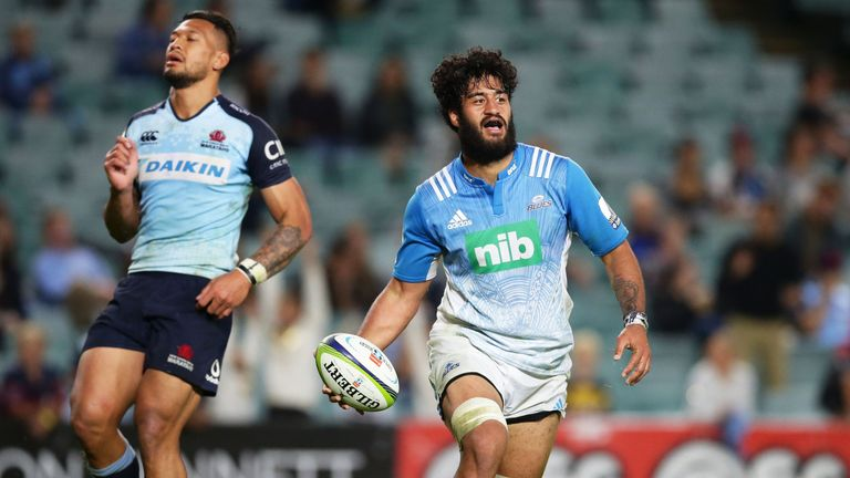 Akira Ioane of the Blues celebrates his try