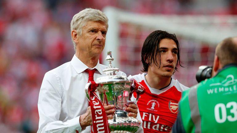 Arsene Wenger holds the FA Cup trophy alongside Hector Bellerin