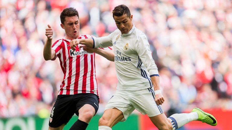 Aymeric Laporte challenges Real Madrid's Cristiano Ronaldo