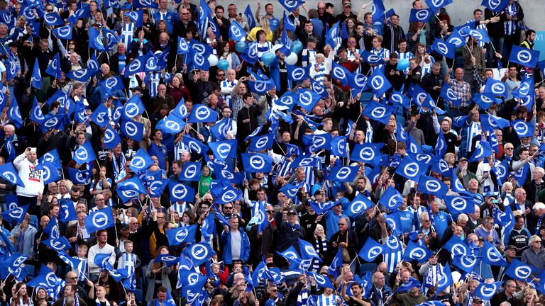 Brighton supporters have been commended by the club's chief executive Paul Barber for their response to homophobic chants from opposition fans