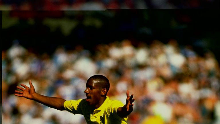 Dion Dublin celebrates scoring for Cambridge