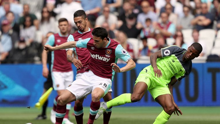 West Ham United's Jonathan Calleri (left) and Liverpool's Georginio Wijnaldum battle for the ball
