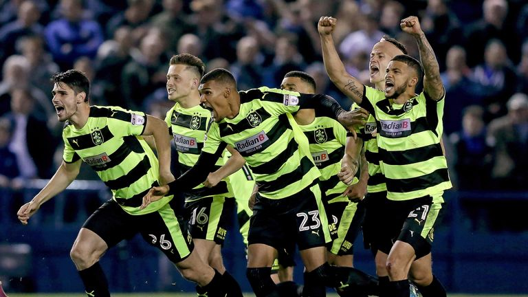 Huddersfield celebrate after Danny Ward (not pictured) saves the final penalty