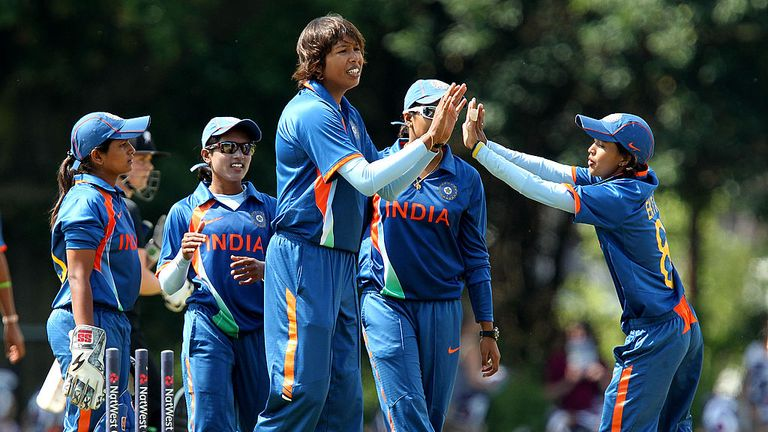 Jhulan Goswami (centre) towers above her India team-mates