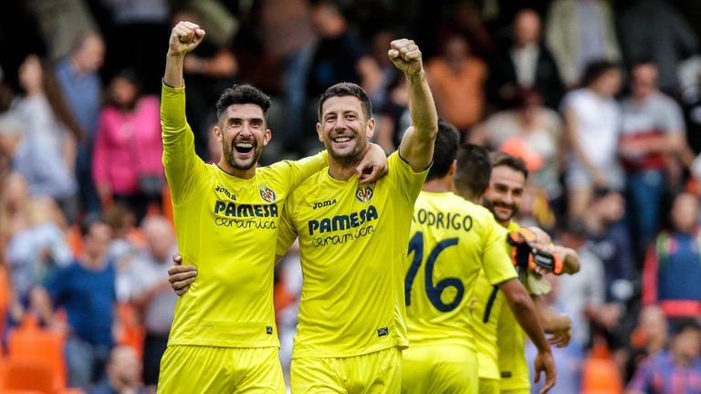 Villarreal's Alvaro Gonzalez (L) and Daniele Bonera celebrate after victory at Valencia