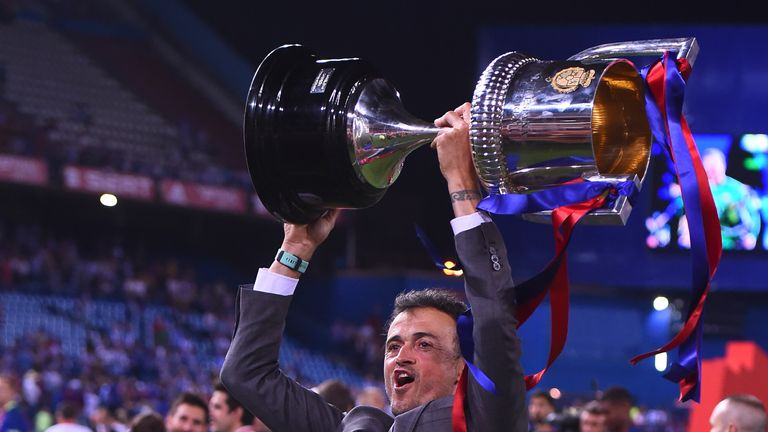 Barcelona's departing coach Luis Enrique holds up the Spanish cup