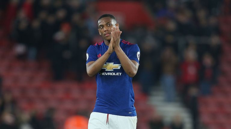 Anthony Martial applauds the travelling fans at St Mary's